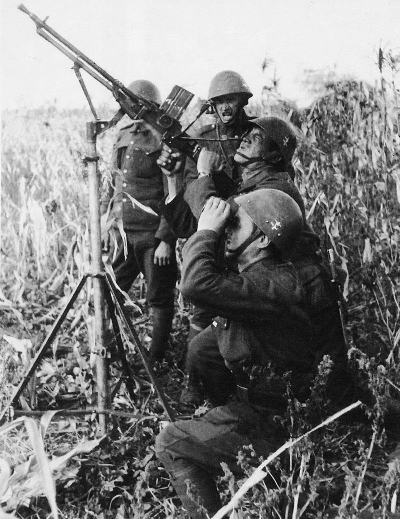 Slovak anti-aircraft gunners firing at a Soviet plane, September 1941