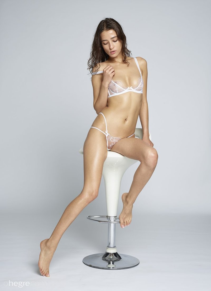 brunette-with-nice-sexy-slim-body-takes-off-her-white-lingerie-on-the-chair-06-w800