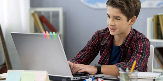 WEB-04-SCHOOLBOY-PLAYING-ONLINE-GAME-ON-LAPTOP-shutterstock-1512343916-Motortion-Films