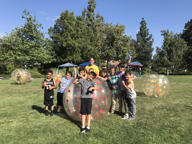 kids catching their breathe after bubble soccer in Laguna Hills on May 5th