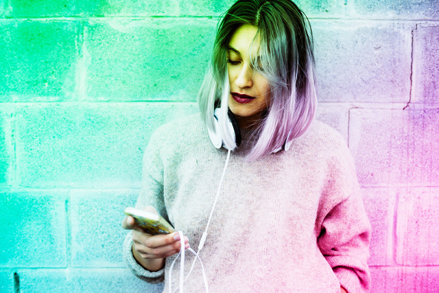 Young-beautiful-caucasian-purple-grey-hair-woman-outdoor-in-the-city-using-smart-phone-hand-hold-and