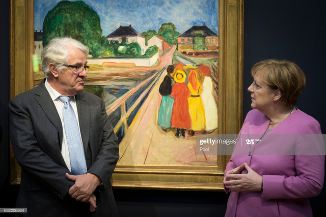POTSDAM-GERMANY-JANUARY-20-German-Chancellor-Angela-Merkel-R-and-Hasso-Plattner-view-the-painting-Gi.jpg