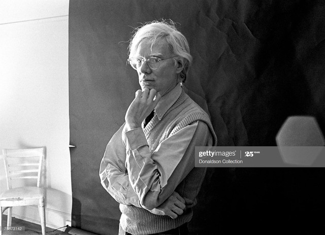 NEW-YORK-Artist-Andy-Warhol-poses-for-a-photo-shoot-at-the-Factory-in-New-York-Photo-by-Michael-Tigh.jpg