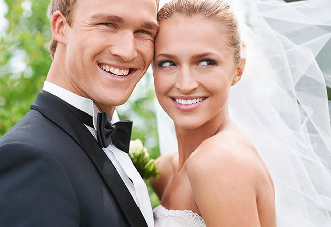 Bride and groom with beautiful white teeth