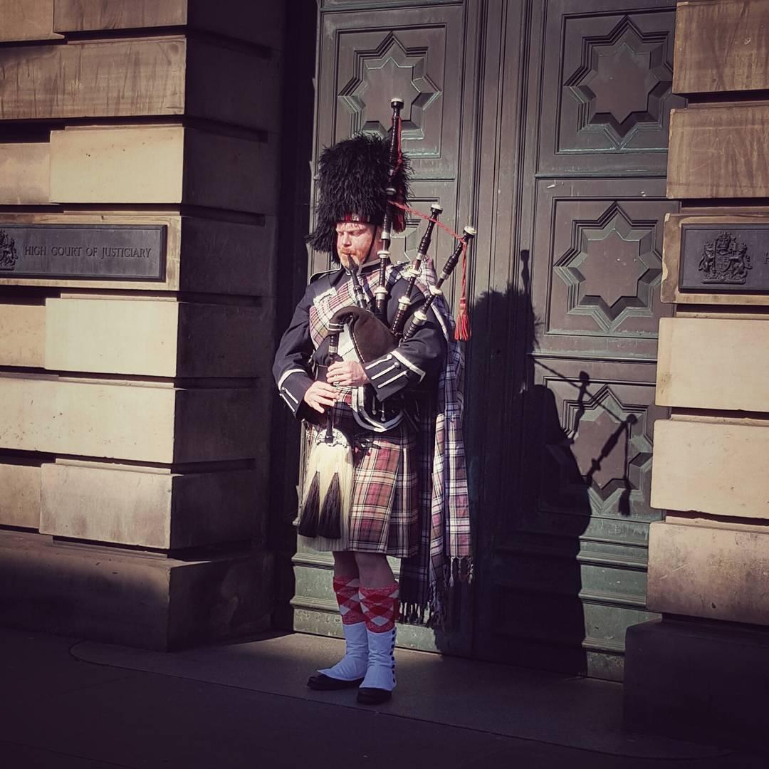 An image of a piper in Edinburgh.