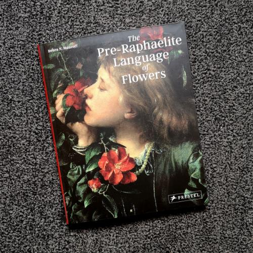 An image of The Pre-Raphaelite Language of Flowers by Debra N. Mancoff.