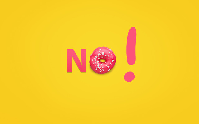 Orange-background-with-pink-glazed-doughnut-and-pink-letter-arranging-word-No-with-exclamation
