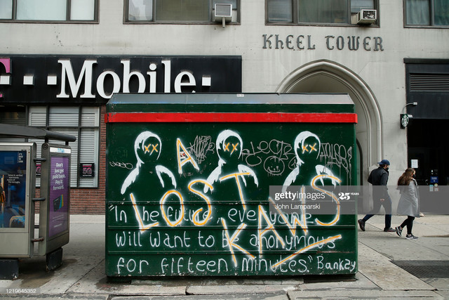 NEW-YORK-NY-APRIL-18-Graffiti-painted-by-Banksy-are-seen-on-the-side-of-a-newsstand-as-U-S-cities-co.jpg