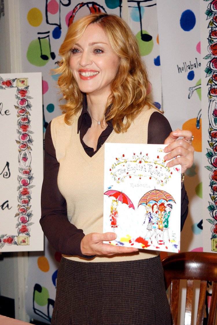 Madonna-holds-a-copy-of-her-book-The-Eng