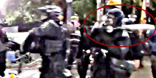 Seattle Rioters Throw Explosives, Officer Gets Whacked In the Head With A Metal Bat…