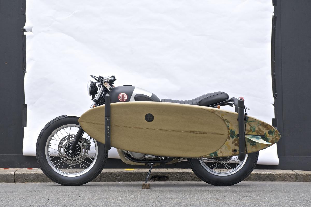 490487-puede-llevar-tabla-surf-moto