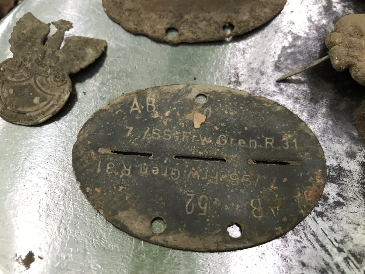 Waffen SS relics found with a metal detector. SS dog-tag