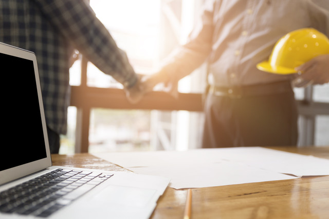 architect engineer shaking hands beside window business teamwork cooperation success collaboration c