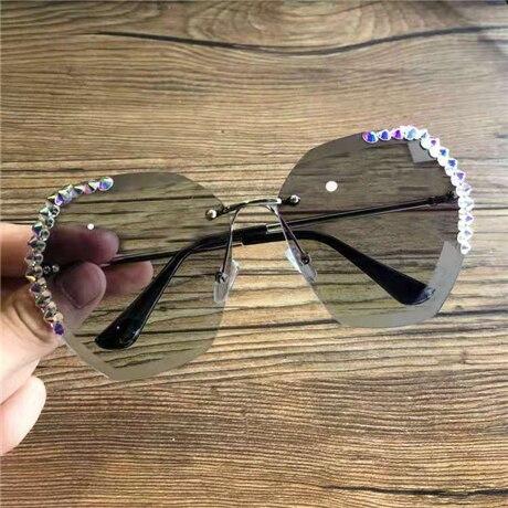 02020-new-women-s-Sunglasses-with-diamond-glasses-1