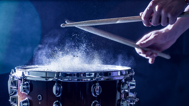 man-plays-musical-percussion-instrument-