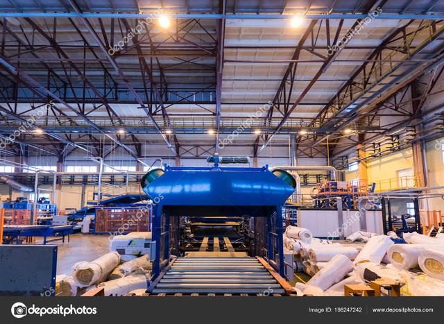 https://i.ibb.co/5sxmFcj/Modern-operational-plant-equipment-producing-fiberglass-with-rolls-of-rock-wool-or-glass-wool-on-the.jpg