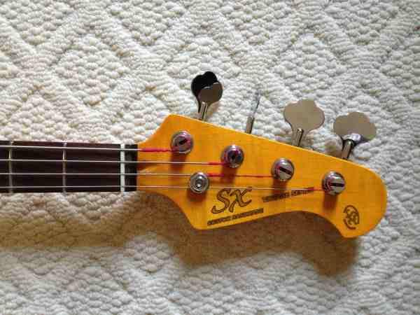 SX com headstock tipo Fender Sx