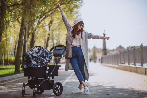 young-mother-walking-with-baby-carriage-park-1303-14353