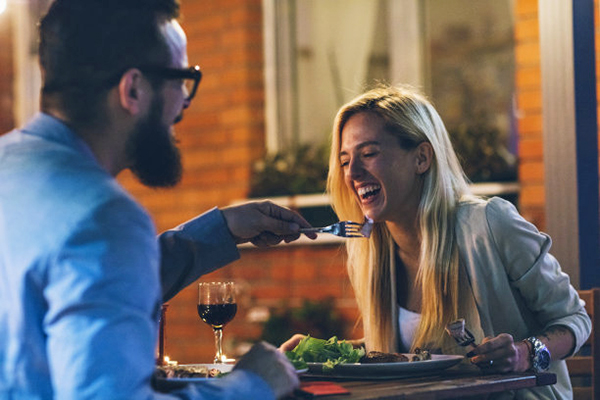 Couple enjoying date night dinner at home