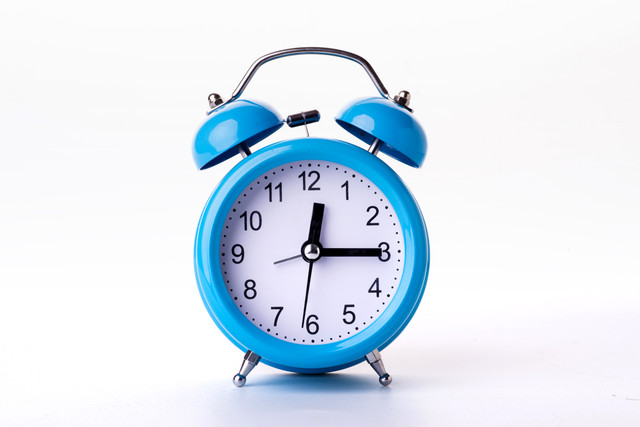 Close-up-of-Pink-Table-Alarm-Clock-on-White-Background