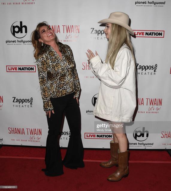LAS-VEGAS-NEVADA-DECEMBER-06-Singer-Shania-Twain-L-and-singer-Kim-Petras-attend-the-grand-opening-of