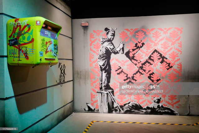 This-picture-taken-on-October-15-2019-shows-a-replica-of-British-street-artist-Banksy-s-artwork-enti.jpg
