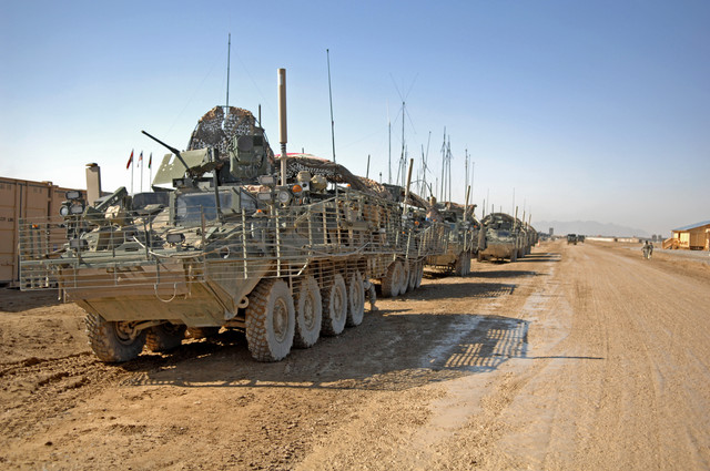 U S Soldiers with Cloak Troop 8th Squadron 1st Cavalry Regiment prepare Stryker armored vehicles to