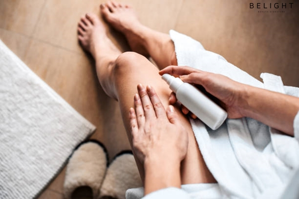 The-girl-in-the-bathroom-puts-anti-cellulite-cream-serum-on-the-legs-and-body-Body-care-concept