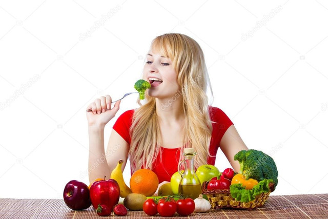 Healthy woman eating fruits vegetables Stock Photo by ©SIphotography  53688297