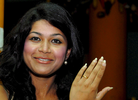 epa01405214-Fiancee-of-confessed-killer-Charles-Sobhraj-not-pictured-Nihita-Bishwas-shows-her-engage