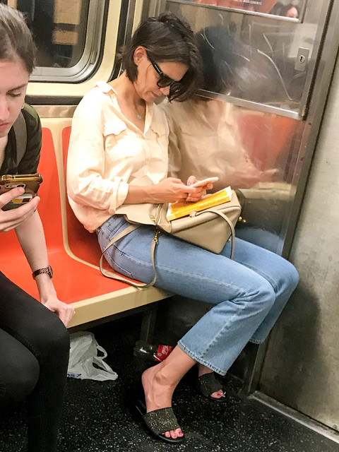 Katie Holmes seen reading her book while in the train as heading home in New York City Pictured Kati