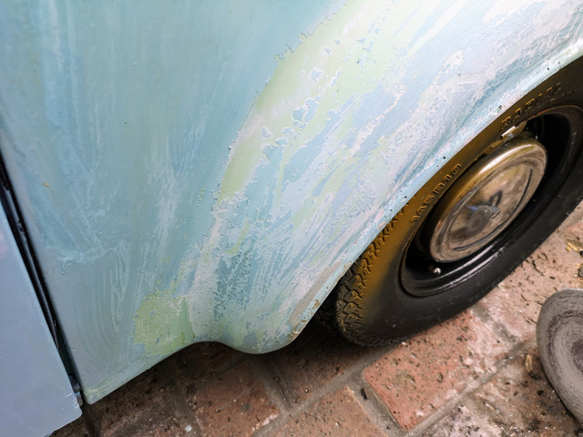 For all the paint is flaking off in sheets in some areas, there are some areas like this wheel arch where it doesn't really want to shift.