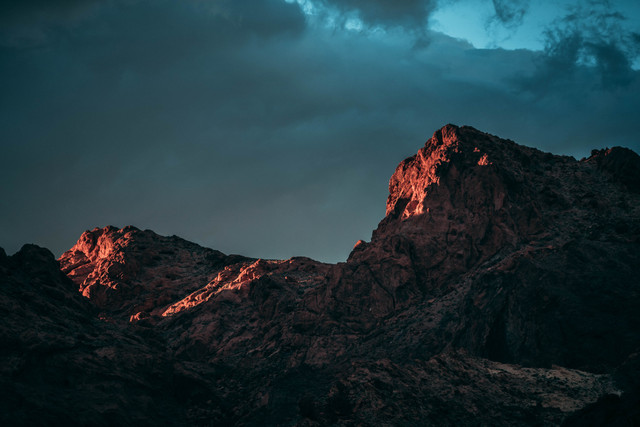 low-angle-photography-of-rock-mountain-under-cloudy-sky-2647990.jpg
