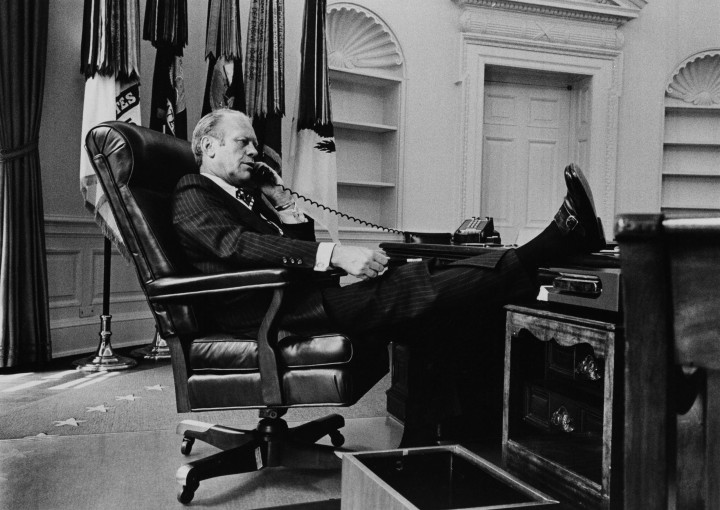 WASHINGTON-AUGUST-11-NO-U-S-TABLOID-SALES-U-S-President-Gerald-R-Ford-takes-a-call-at-his-desk-in-th