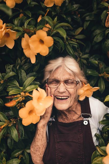 woman-standing-near-yellow-petaled-flower-2050994