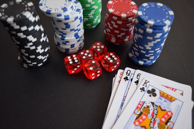https://i.ibb.co/CbDxRKn/card-game-on-poker-platform.jpg