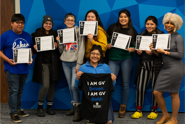 Students posing with their award certificates at the I Am GV award ceremony