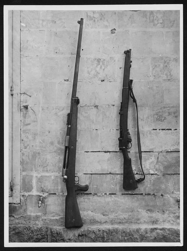 German anti-tank rifle and British SMLE rifle.