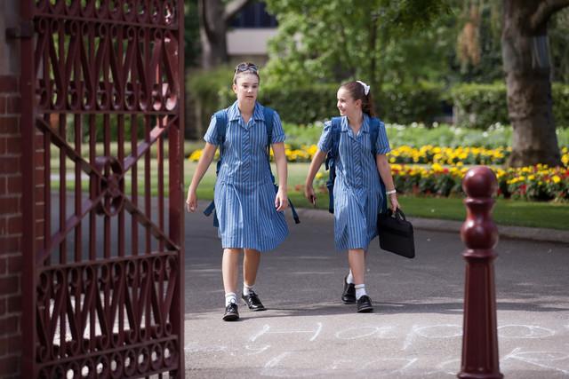 private school girls walk into school