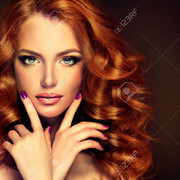 46401809-girl-model-with-long-curly-red-hair-trendy-image-red-head-woman-and-purple-nails