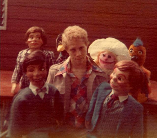 ventriloquist-dummy-surround-young-man