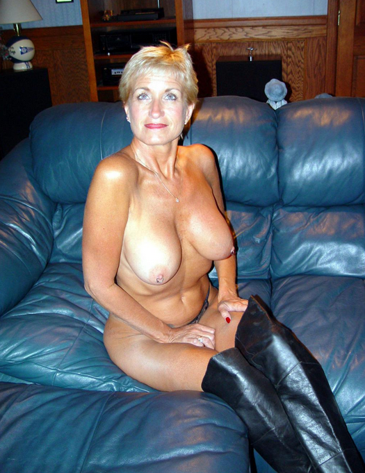 Horny naked grandma sits on couch waiting for other members to join her for an orgy in Melbourne
