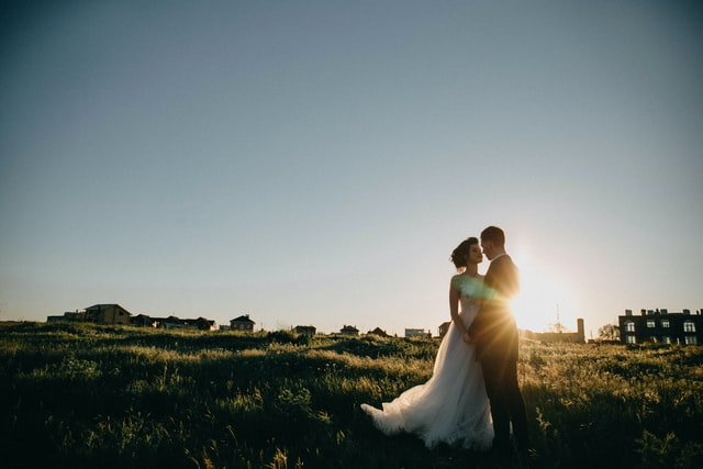 An image of a wedding couple at sunset.