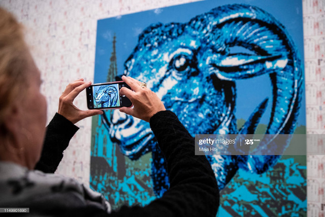 DUSSELDORF-GERMANY-MAY-17-Visitor-looks-at-the-Zodiac-series-LEGO-portrait-series-made-by-Chinese-ar.jpg