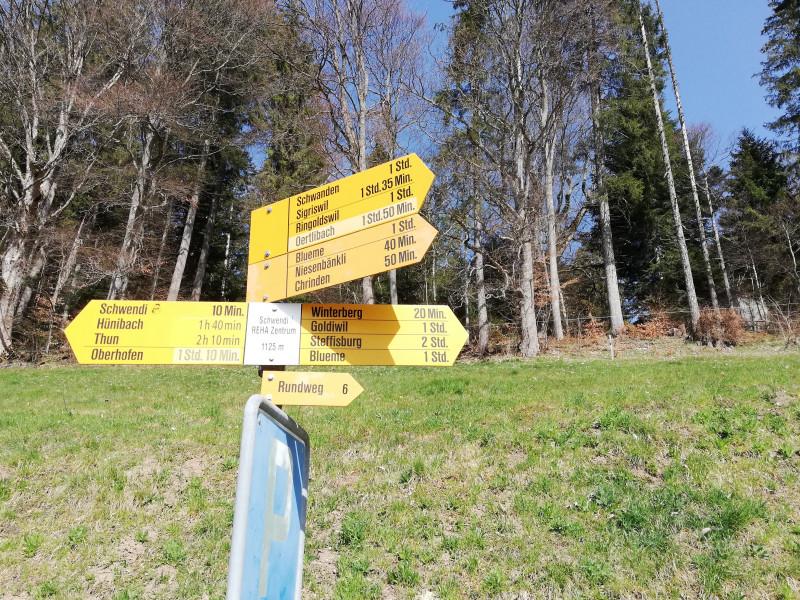 Hiking trail sign at Reha Center Bern