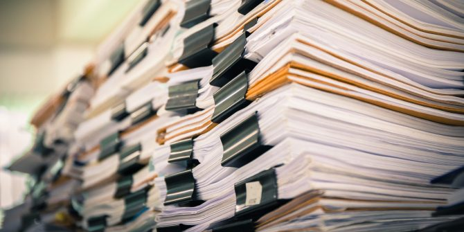 stack-papers-research-folders-670x335