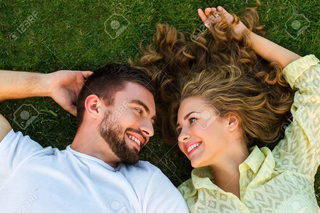 [Image: happy-couple-lying-on-the-grass-in-the-g...s-rest.jpg]