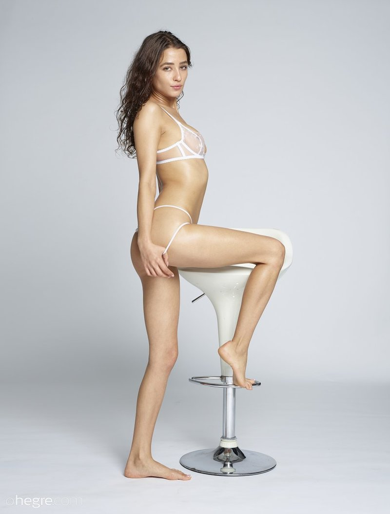 brunette-with-nice-sexy-slim-body-takes-off-her-white-lingerie-on-the-chair-04-w800