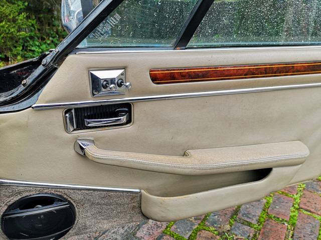 Refinished wood trim refitted to the driver's door card.  Looks far better!