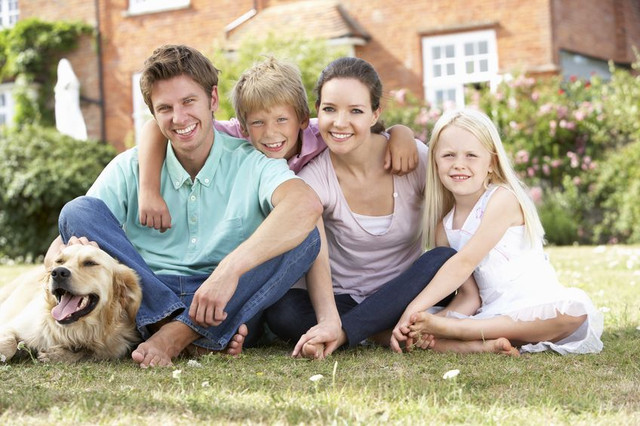 Image of family with their dog